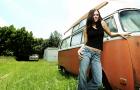 Girl standing by a van